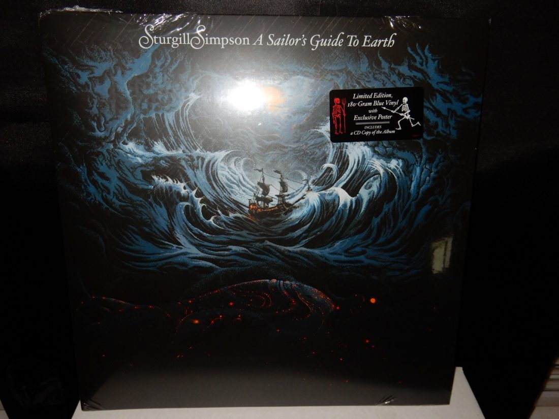 "180 gram vinyl LP pressing including bonus CD edition. 2016 release, the third album from the country singer/songwriter. Produced by Simpson, A Sailor's Guide To Earth was written-beginning to end-as a letter to his first child who arrived during the summer of 2014 and features eight original songs as well as a rendition of Nirvana's ""In Bloom."" Recorded primarily at Nashville's The Butcher Shoppe, Simpson was joined in the studio by Grammy Award-winning engineer David Ferguson (Johnny Cash, John Prine, ""Cowboy"" Jack Clement) and assistant engineer Sean Sullivan. Along with members of his touring band, the album features Dave Roe on bass, Dan Dugmore on steel guitar, Dougie Wilkinson on bagpipes, Garo Yellin and Arthur Cook on cello, Jonathan Dinklage and Whitney LaGrange on violin and special guests The Dap-Kings. A Sailor's Guide To Earth follows his break-through, Grammy-nominated 2014 release, Metamodern Sounds In Country Music. Beloved by critics and fans, the record was featured on year-end ""best of"" lists at The New York Times, Rolling Stone, the Village Voices' Pazz and Jop, Rolling Stone Country, NPR Music, American Songwriter, Stereogum, the Los Angeles Times, KCRW, Pitchfork, The Washington Post and many others."